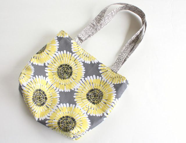 Easy Fat Quarter Bag Tutorial: I made this today, and it turned out exactly like in the picture! The tutorial was very easy to follow. It was the first time I have ever made anything on a sewing machine. With more fabric, I could make a larger bag for the farmers market! You could make any size or shape too!