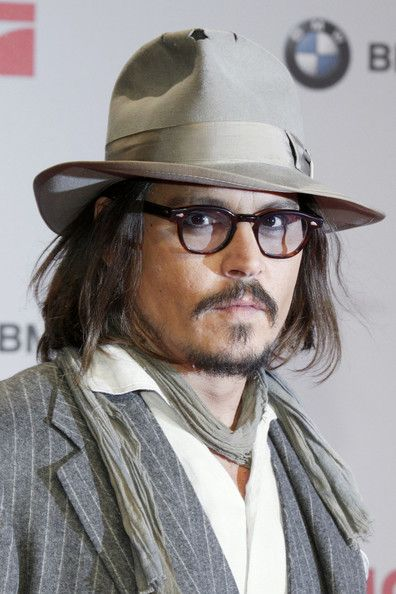 Johnny Depp Fedora - Johnny Depp paired his eccentric look with a taupe fedora  hat.Dec 15 2010   The Tourest Pre in Berlin 323868a60e5