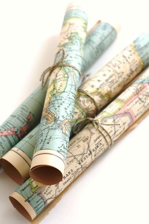 Rolled maps in clear container on bookshelf - home office?