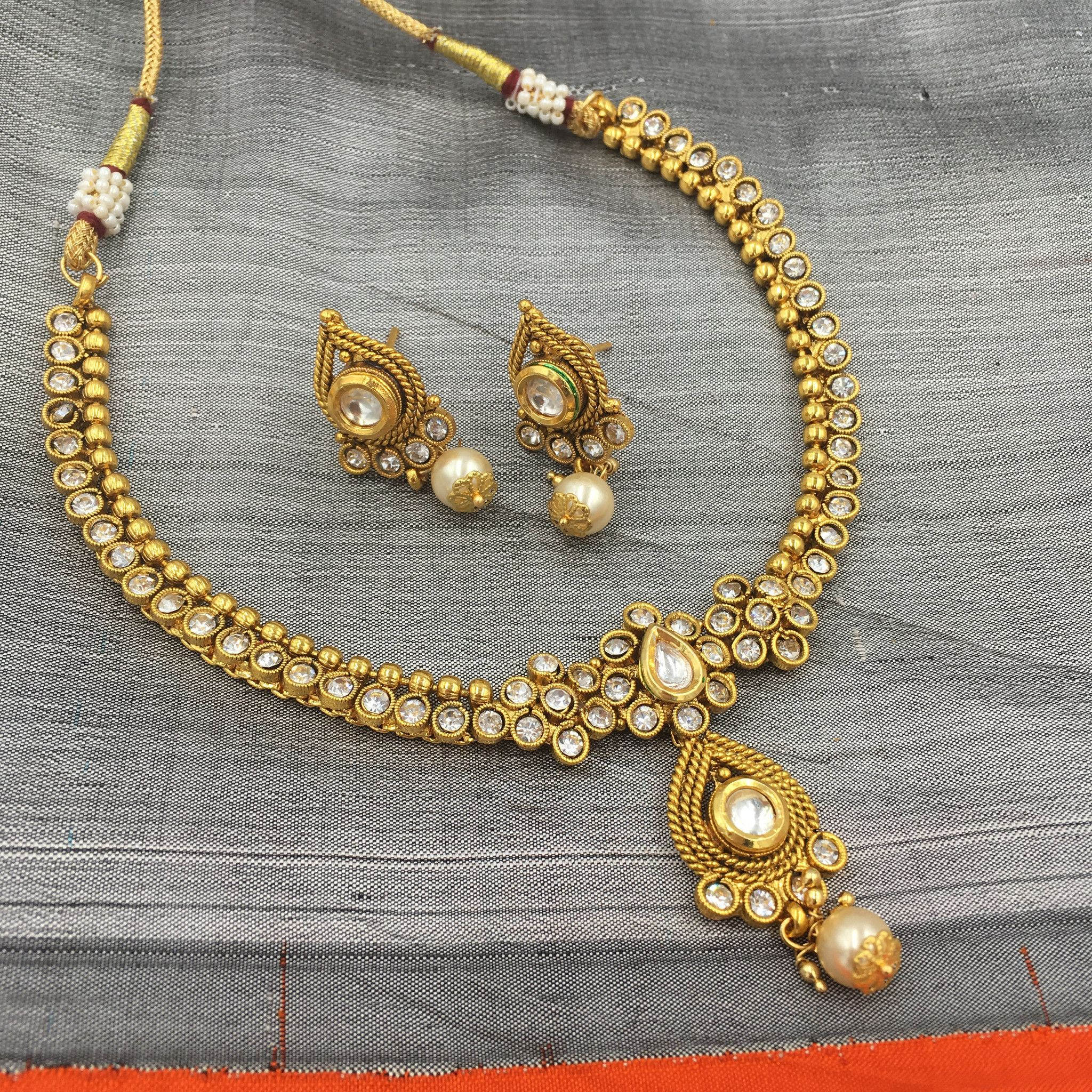 Fit necklace with white stones and pearl drop pendant a ray of