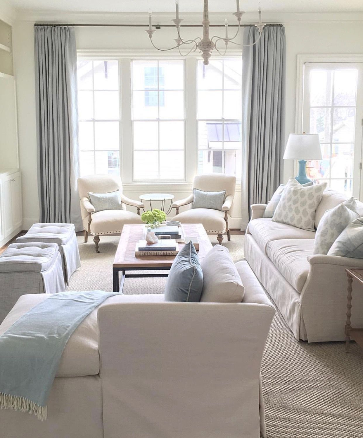 Neutral Space With Light Blue Pillows Throw Lamp And Drapes