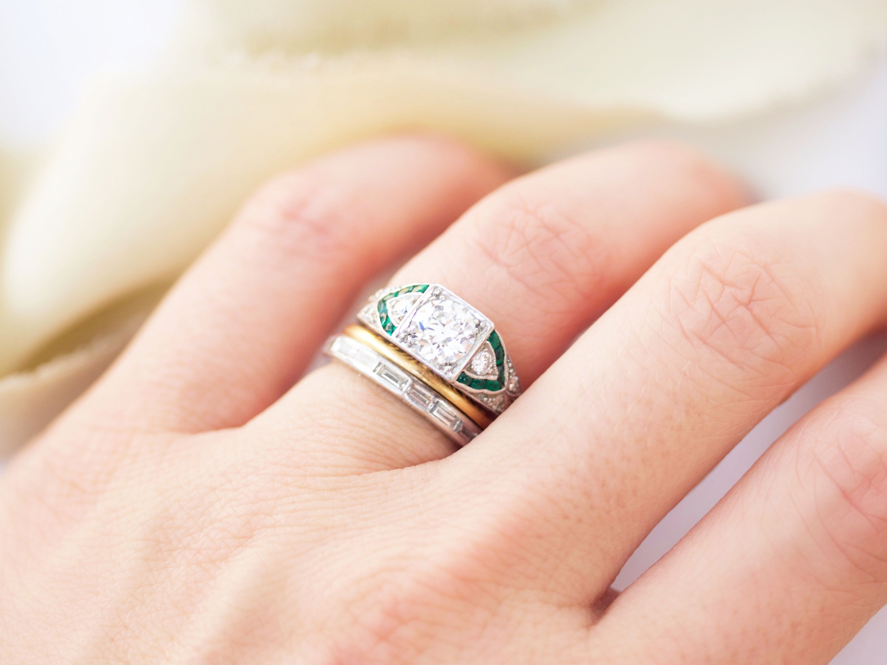 Art Deco Old European cut diamond in a platinum setting with green emerald accents from Victor Barbone Jewelry!