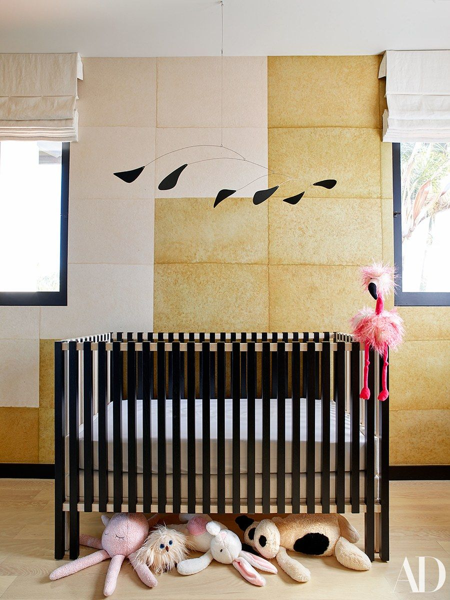 A calder inspired mobile hangs in the nursery