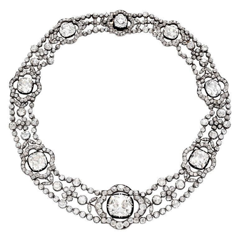 Important Victorian Diamond Necklace, Great Britain. Eight large cushion cut diamonds weighing approximately 79.09 cts; each large cushion cut diamond measures approximately 4.76, 6.37, 6.92, 6.93, 6.97, 9.13, 10.92 and 27.09cts, surrounded by an additional approximately 40cts of diamonds, mounted in silver topped gold, circa 1880-1890.