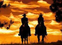 Couple riding into sunset