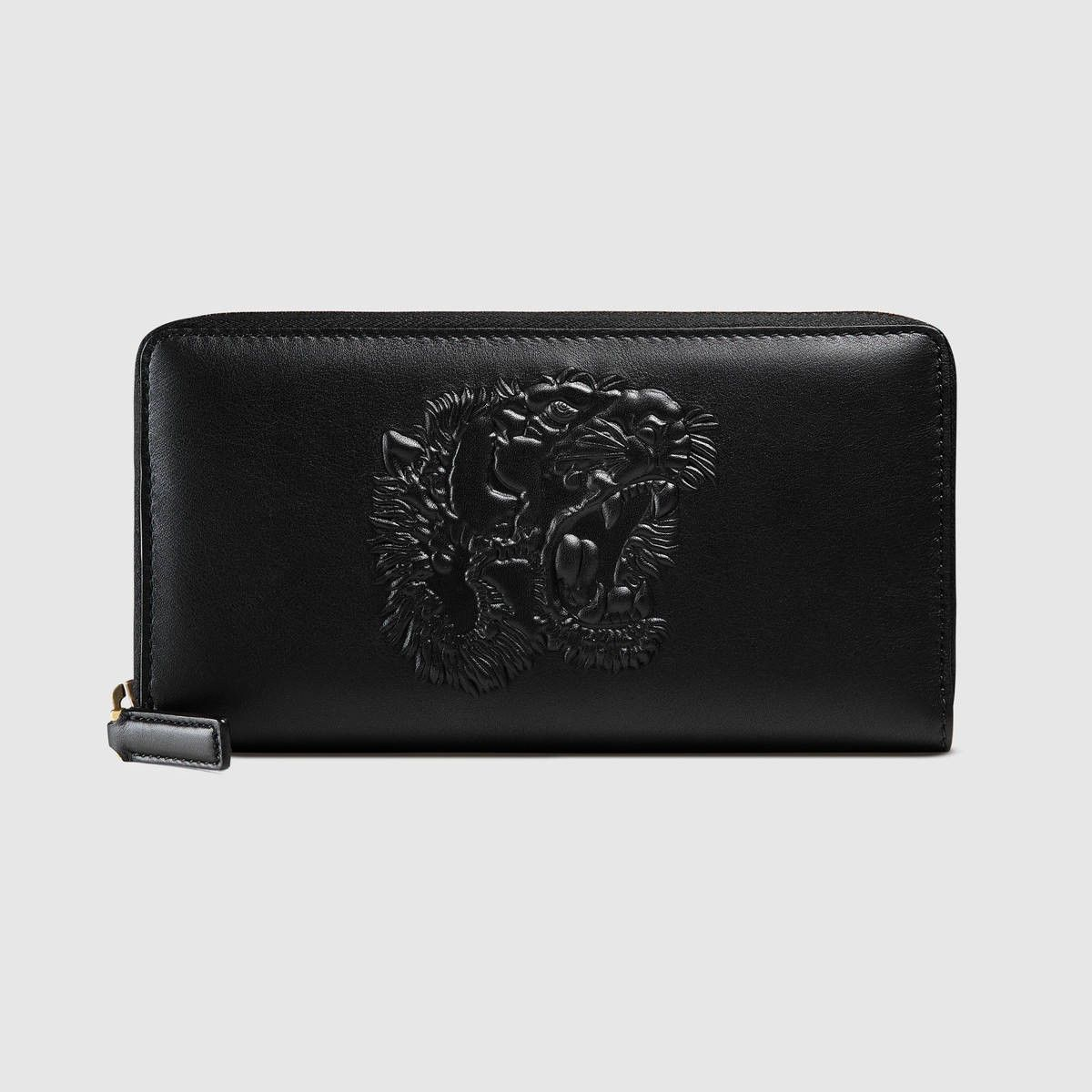 23a7299bc70c GUCCI Tiger Embossed Zip Around Wallet - Black Embossed Leather. #gucci #all