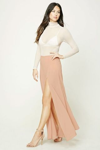 504b143010b6 A semi-sheer crepe woven maxi skirt featuring a high side slit, a panty  underlayer, and a concealed side zipper.