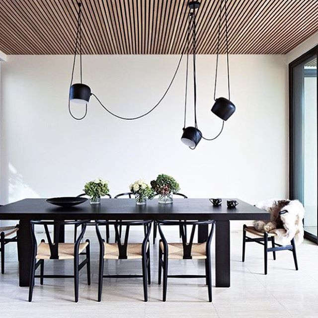 Midcentury modern dinning space with a large exposed cord chandelier