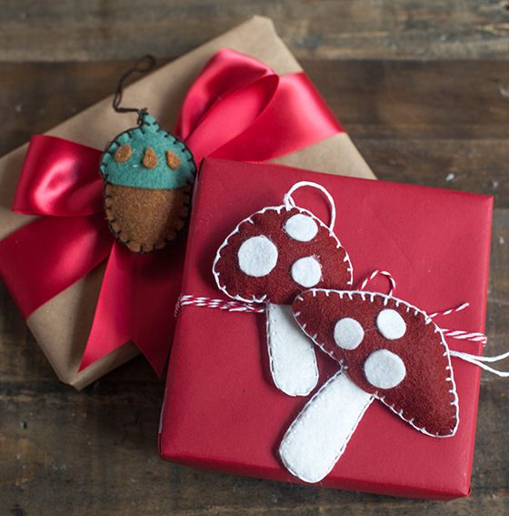 DIY Felt Gift topper in warm, wooly woodland style. Here are the acorn and mushroom patterns and tutorial by handcrafted lifestyle expert Lia Griffith.