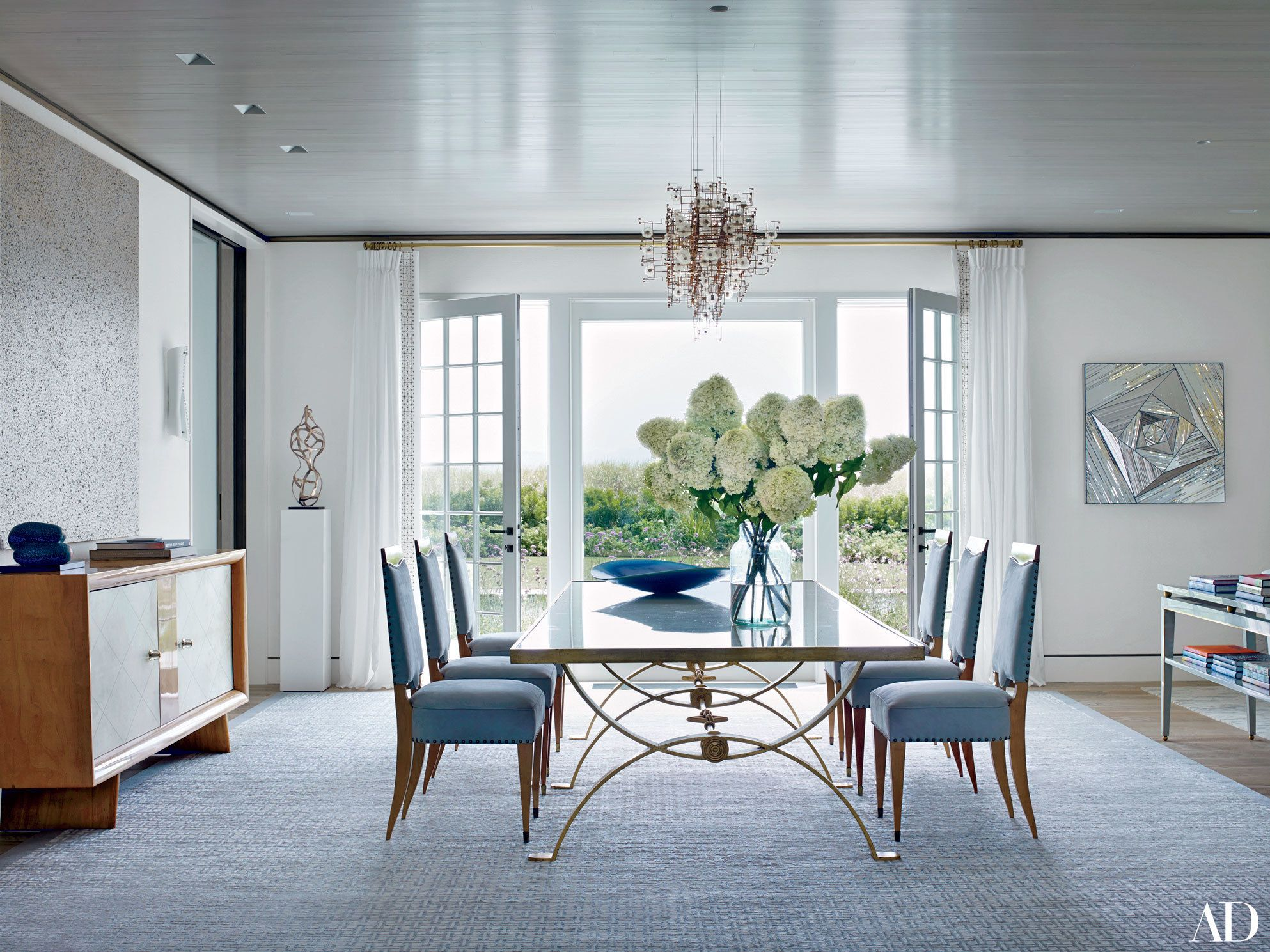 A Studio Drift Ceiling Light From Carpenters Workshop Gallery Hangs In The Dining Room Coastal Interior Of Neutrals And Ocean Hues
