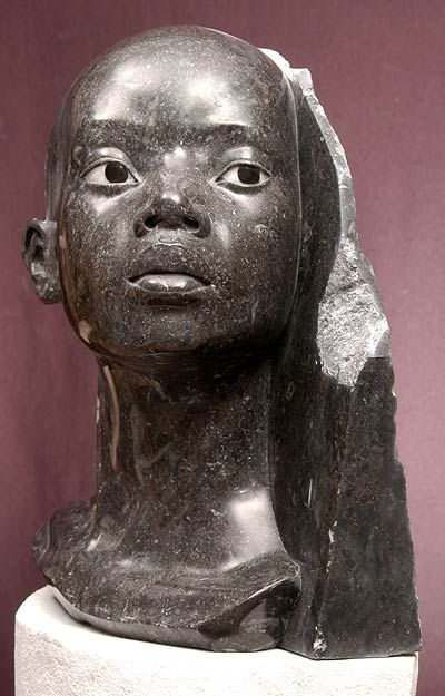 """Amistad"" is a one of a kind, fragmented marble bust over life size and weighs 57lbs. Her eyes are inlaid with white and brown alabaster. By Philippe Faraut"