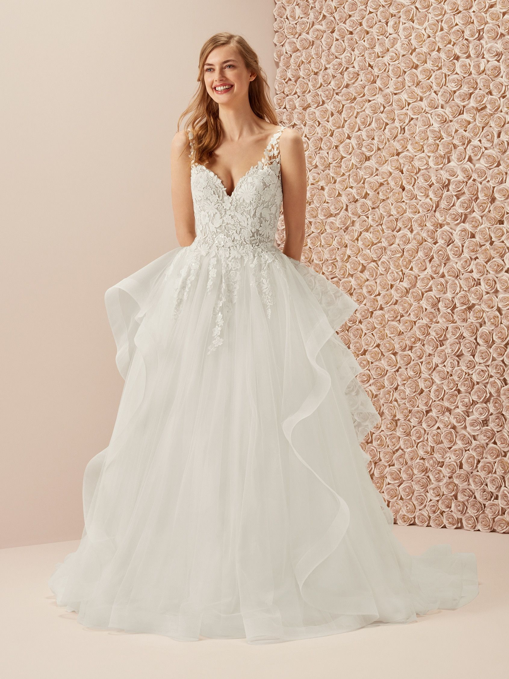 1b4310e2d8bc *love this one!* Marea is a princess wedding dress with a very full skirt  crafted of uneven ruffles in tulle and a lovely lace bodice with flowers |  ...