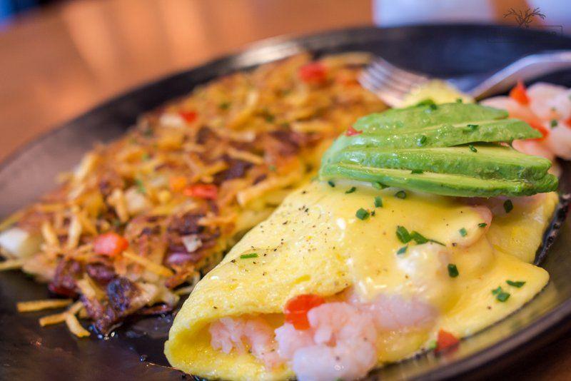 SHRIMP OMELET eggs w/ gulf shrimp, vermont white cheddar, avocado, Scott's lemon hollandaise + hashed browns