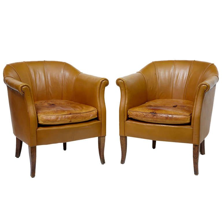 pair of early 20th century french leather tub chairs