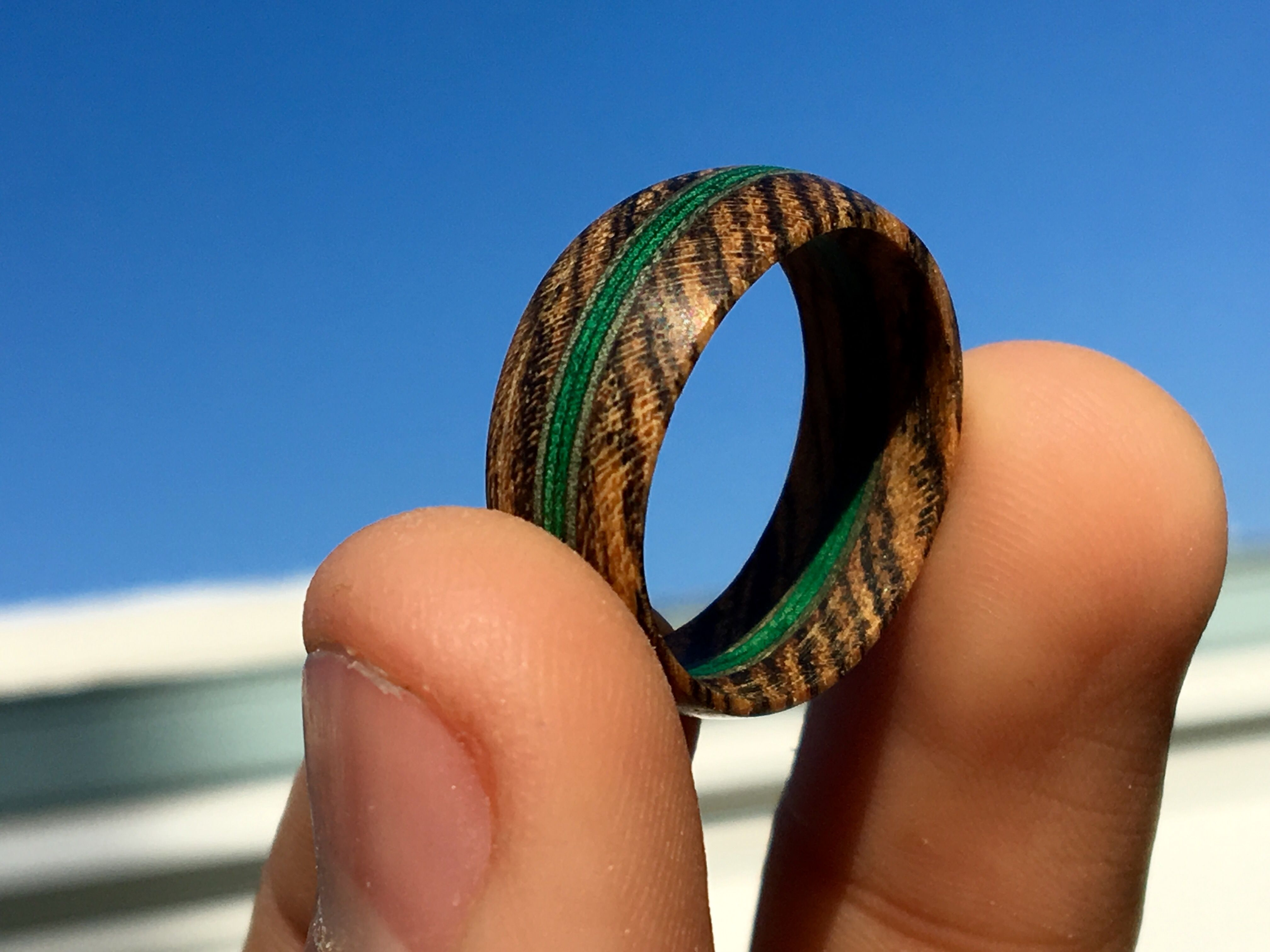 Handcrafted wood ring made from Bocote wood and green
