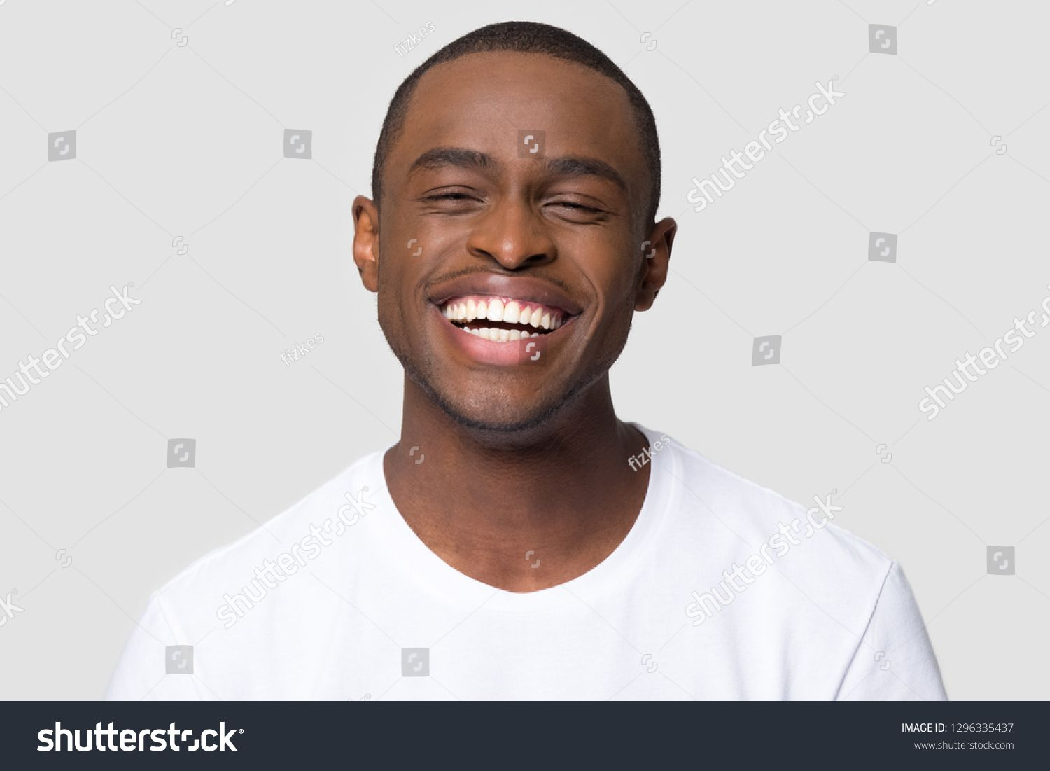 Cheerful Happy African Millennial Man Laughing Looking At Camera Isolated On Studio Blank Background Funny Young Black Guy With Photo Editing Man Stock Photos