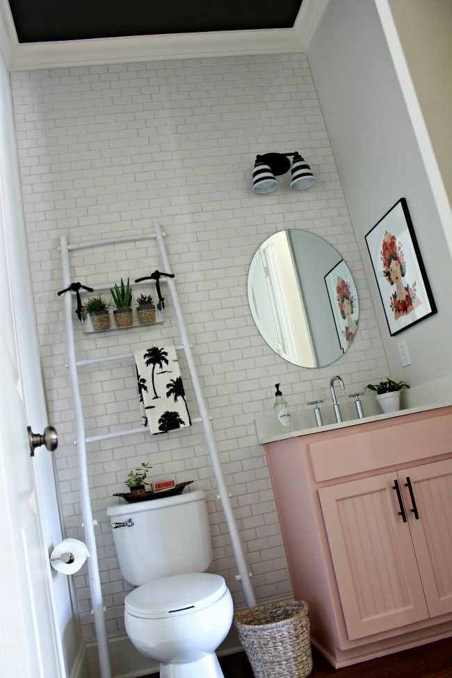 Brighten Up A Dark Bathroom Open Shelving Pastel And Gold Touches Half Moon Hamper Small Bathroom Furniture Classic Small Bathrooms Small Bathroom Decor