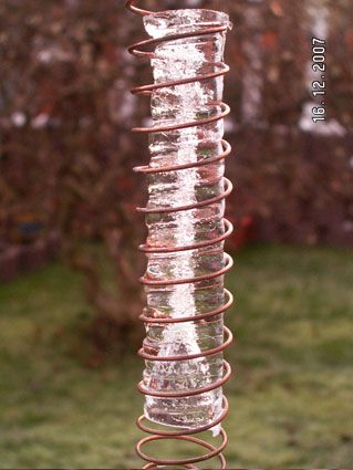 Water frozen in vortex in a cloudbuster pipe with copper