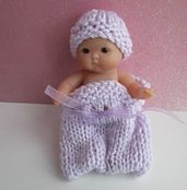 "This is just a quick and easy pattern for a 5"" Berenguer or similar doll. The cozy is knitted in one piece."
