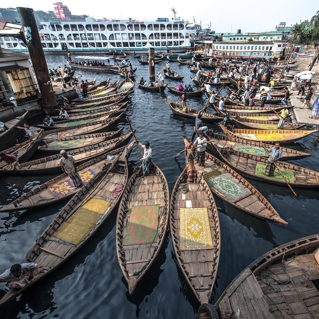"""""""Downtown Dhaka's Buriganga is one of the most polluted rivers in the world, and life is hard for most who live or earn a living from it. Still, the area surrounding the ferry ghat (quay) is often full of life and cheer. It reminded me of scattering the colorful petals of a flower on a black surface."""" -@careldegroot Dhaka, Bangledesh #passionpassport"""