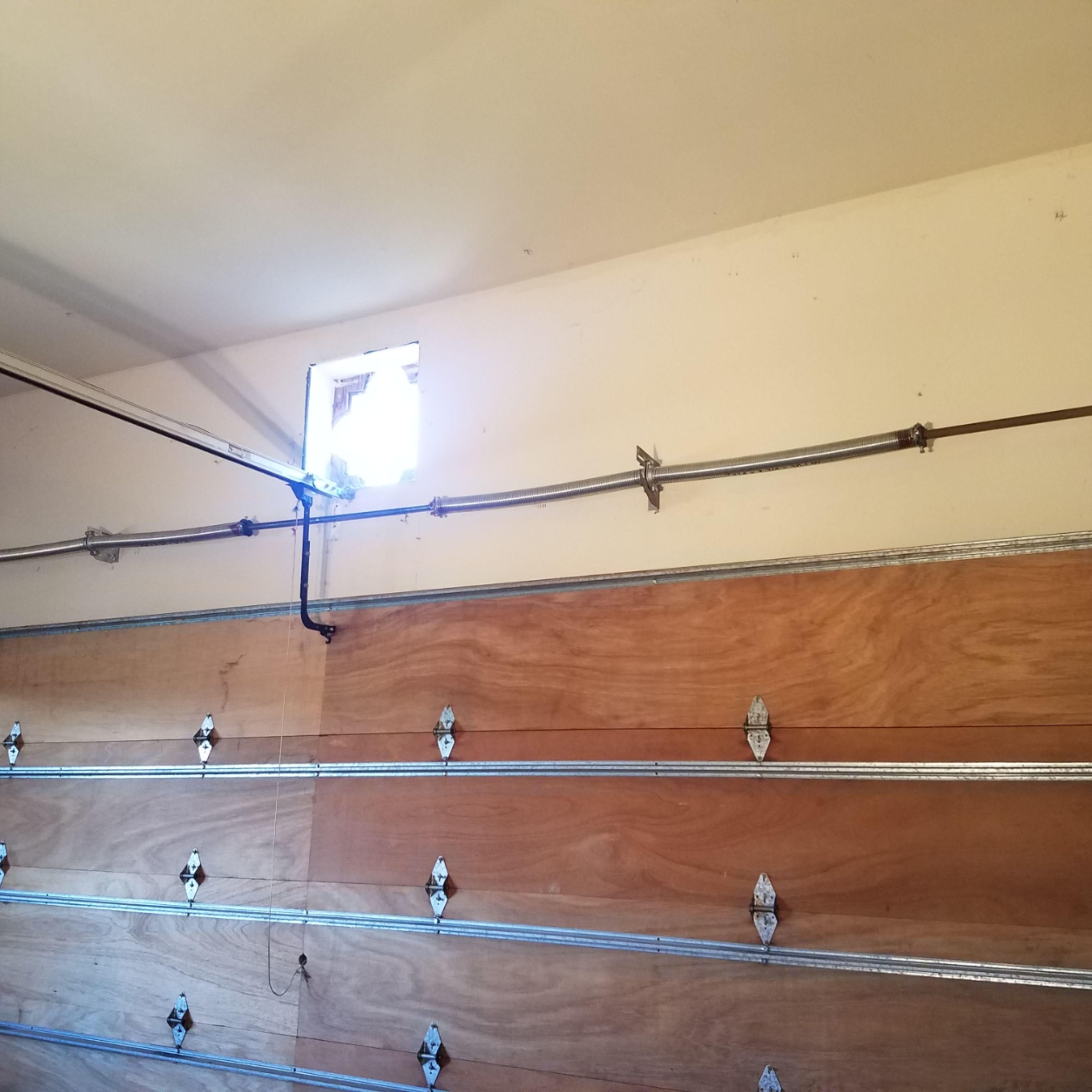 Garage Door Spring Conversion Service In 2020 Garage Door Springs Garage Door Spring Repair Garage Door Repair