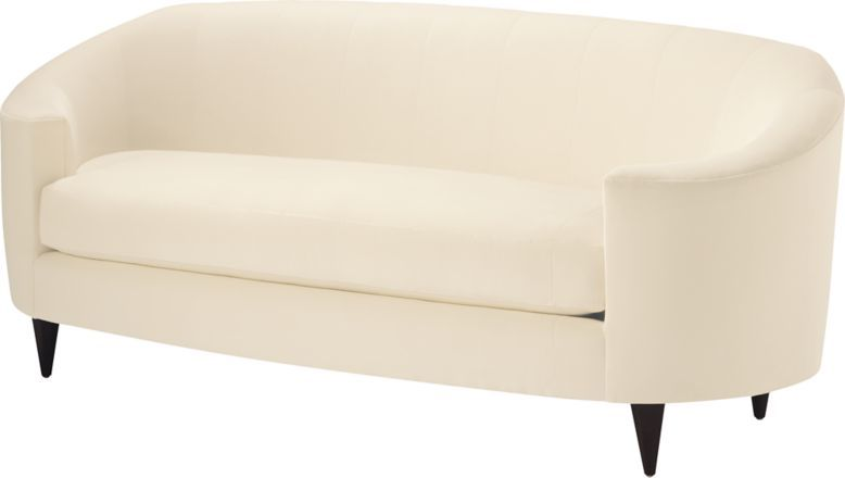An Oval Sofa With Deeply Curled Arms Notched Bench Seat Tapered Hexagonal Legs