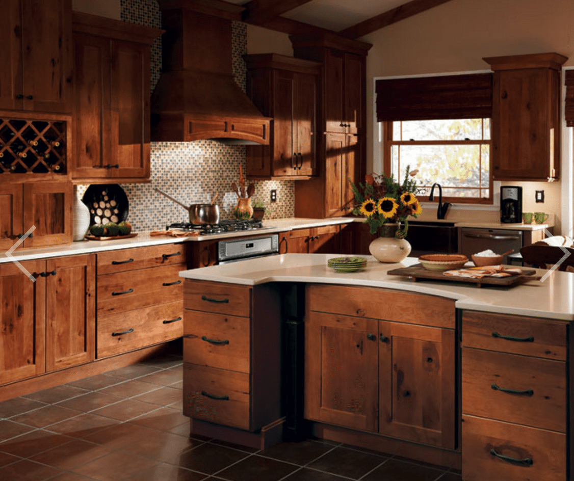 Here S How To Get Tuscan Style At Home Hickory Kitchen Cabinets Tuscan Kitchen Tuscany Kitchen