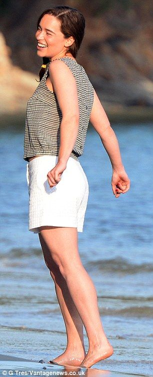 Easy living: Emilia dipped her feet into the water in Palma de Mallorca where she is filmi...