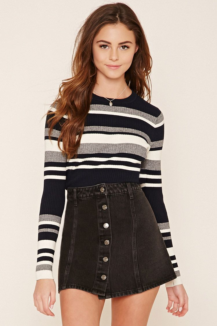 a denim skirt featuring a button front belt loops and