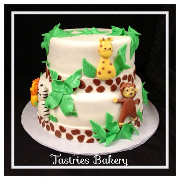 It's a boy!!!  Adorable safari baby shower cake. Photo by tastriesbakery