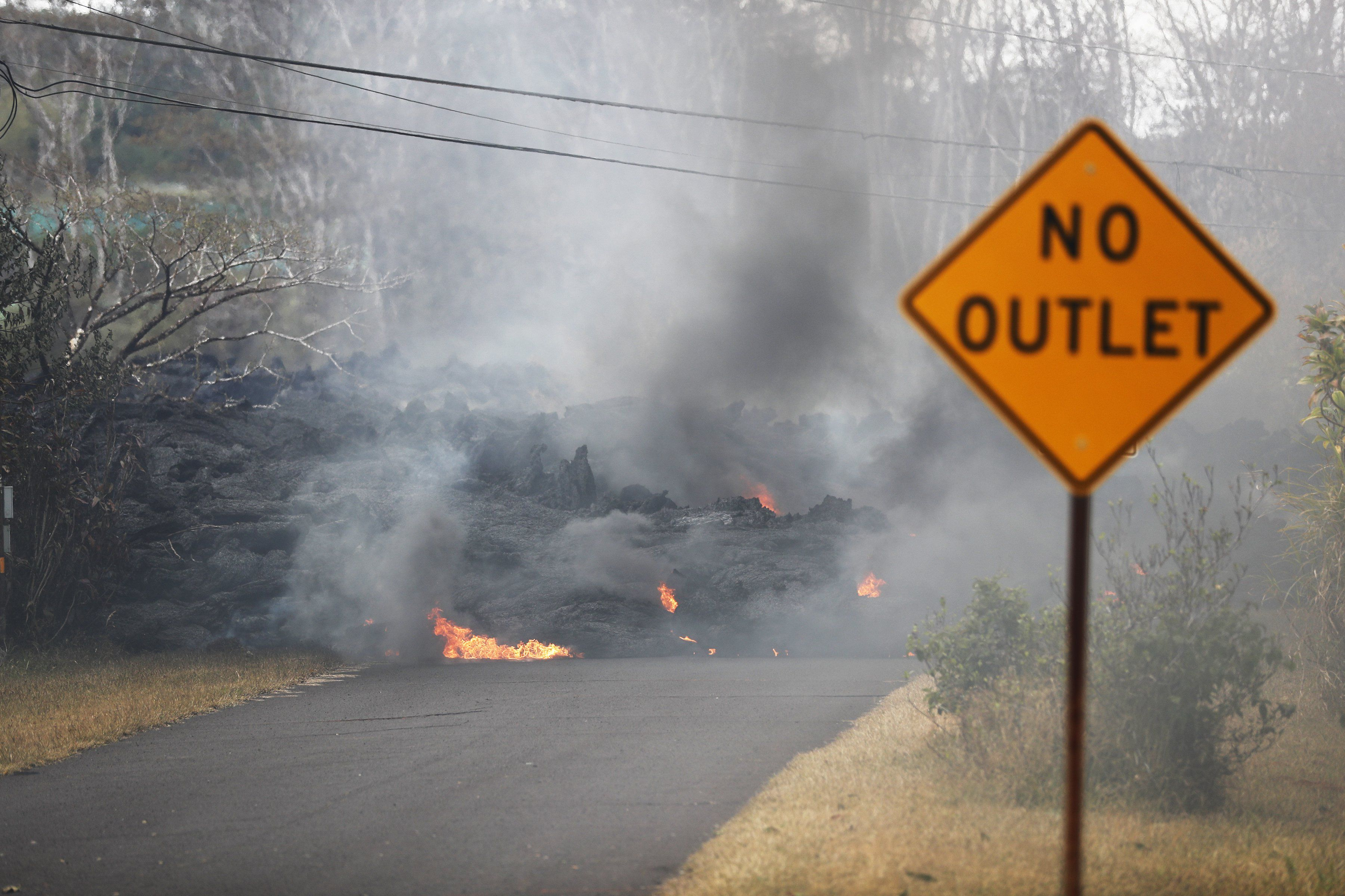 lava crossed a road and isolated about 40 homes below hawaii s rh pinterest ca