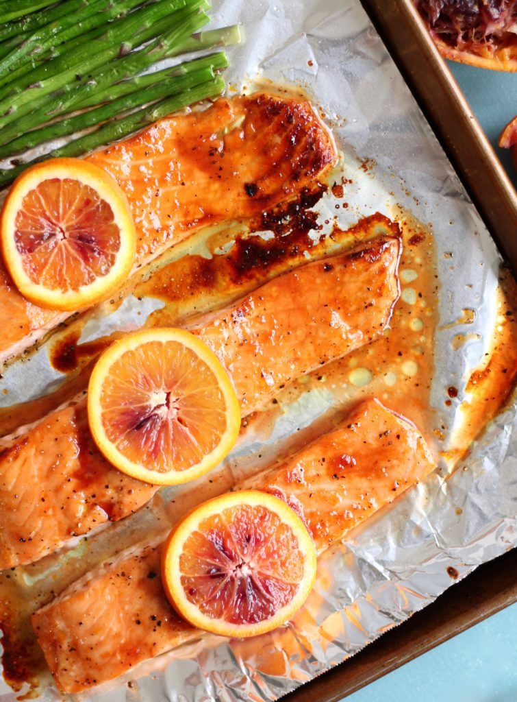Blood Orange Honey Glazed Salmon – In need of a healthy yet hearty meal? This three-ingredient Blood Orange Honey Glazed Salmon dish is an amazingly nutritious meal that tastes great with asparagus or broccoli. Salmon coated with honey and sliced blood oranges is baked to perfection in only 15 minutes. You won't believe the flavor that comes from just those few simple ingredients!