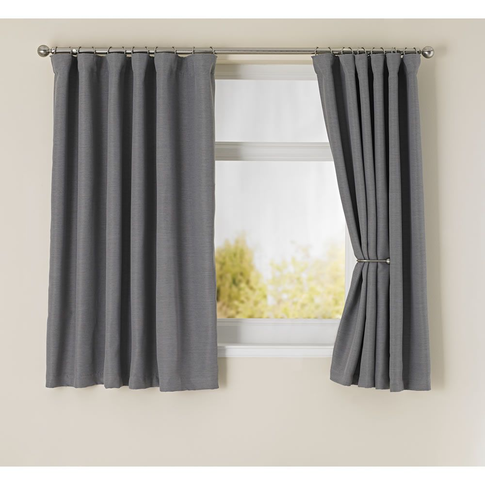 Light grey window curtains -