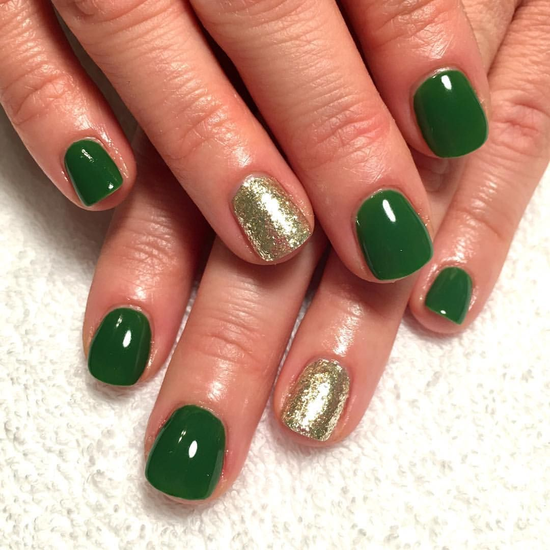 Green and gold gel nails! See this Instagram photo by @nails