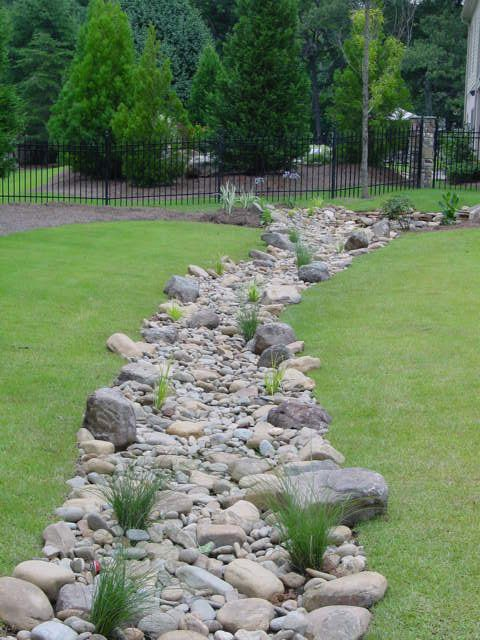 Garden Design Dry River Bed k::::::: along split rail fence..with plantings to mimic