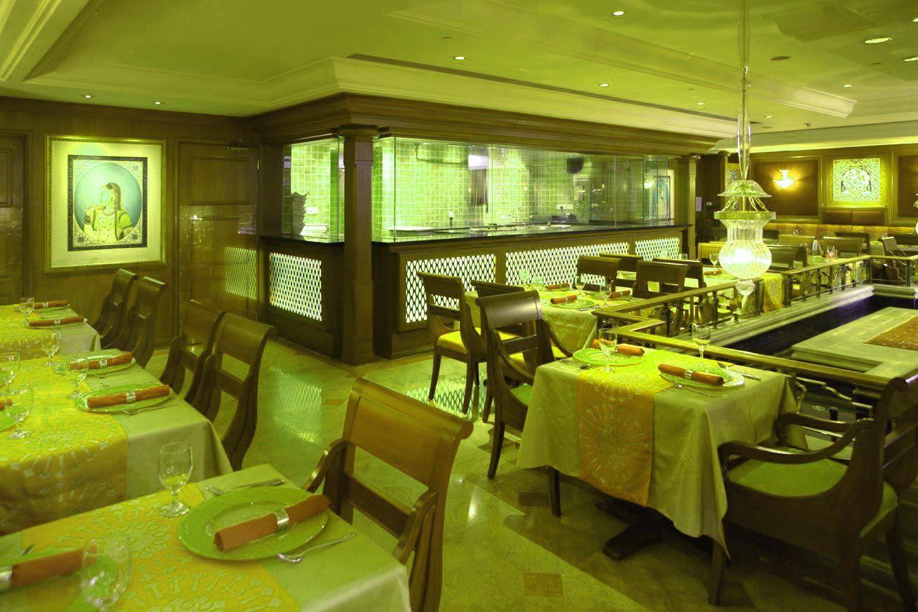 Green color multi cuisine restaurant interior designers in