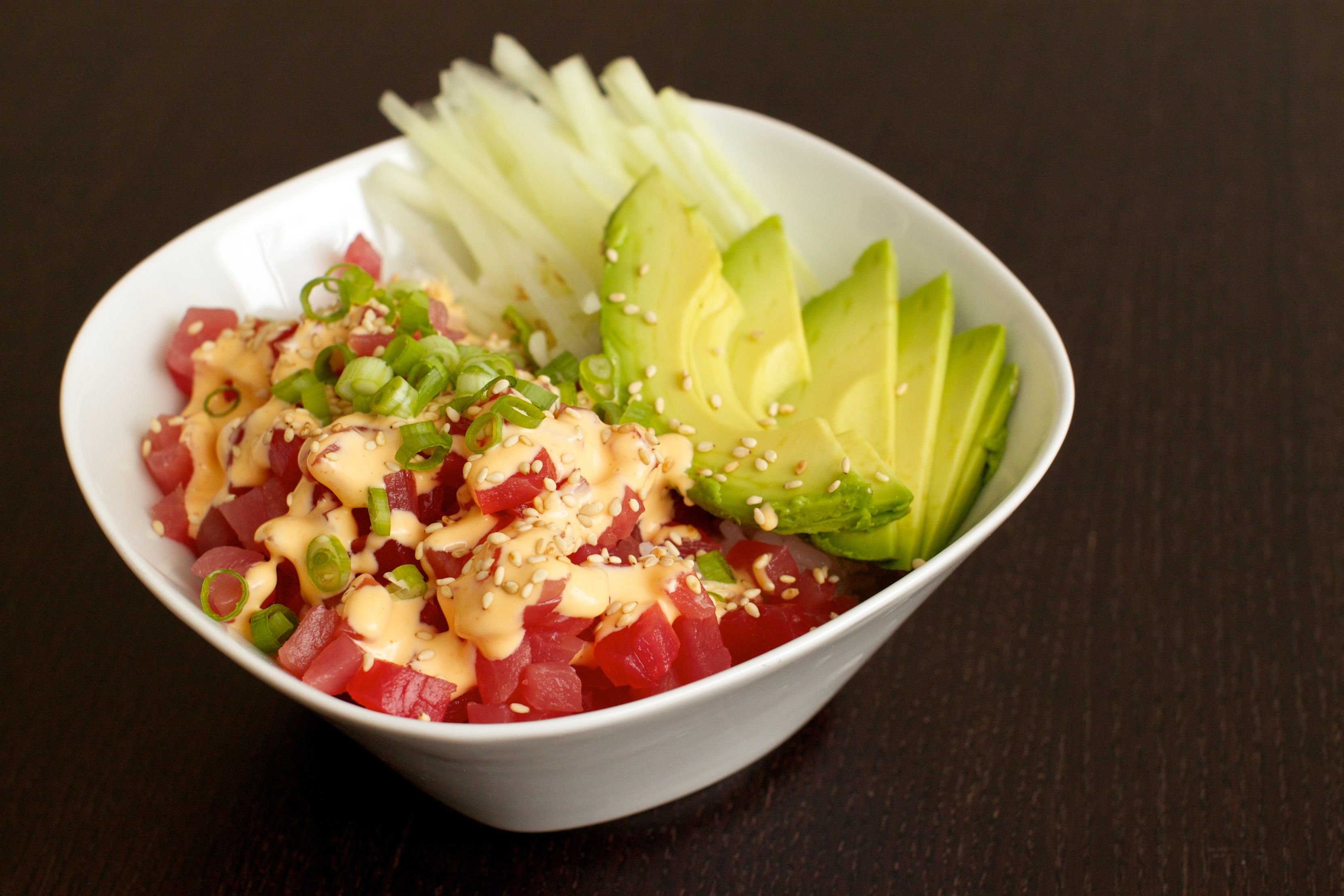 spicy tuna rice bowl---  good in small doses. make sure if using raw fish to cut into really tiny pieces. too weird otherwise. could do with imitation crab as well