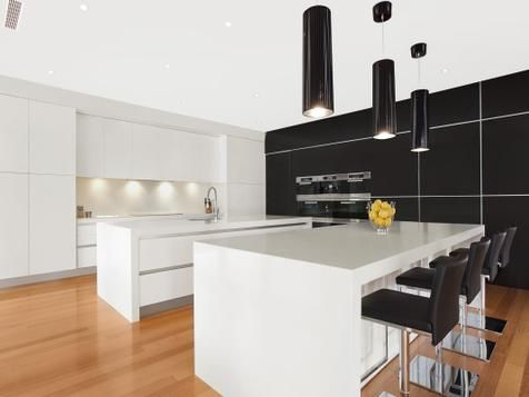 FUNCTIONAL FUSION This kitchen features white gloss cupboards with a