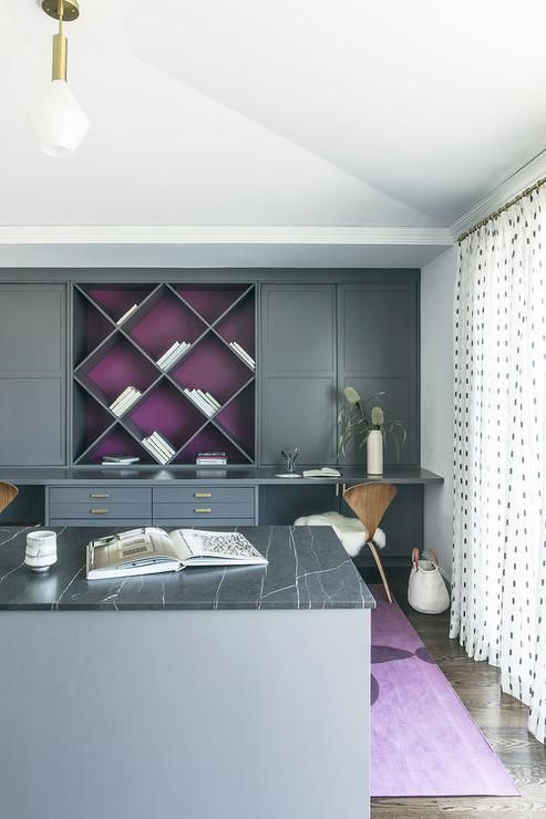 gray built in cabinets with brass hardware flank a built on home office color schemes id=45357