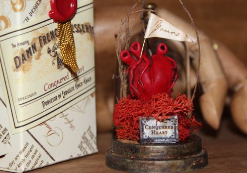 Miniature sculptures in bell jars including the Conquered Heart, Brain in Love and Butterflies in my Stomach by damnfrenchdesserts on Etsy