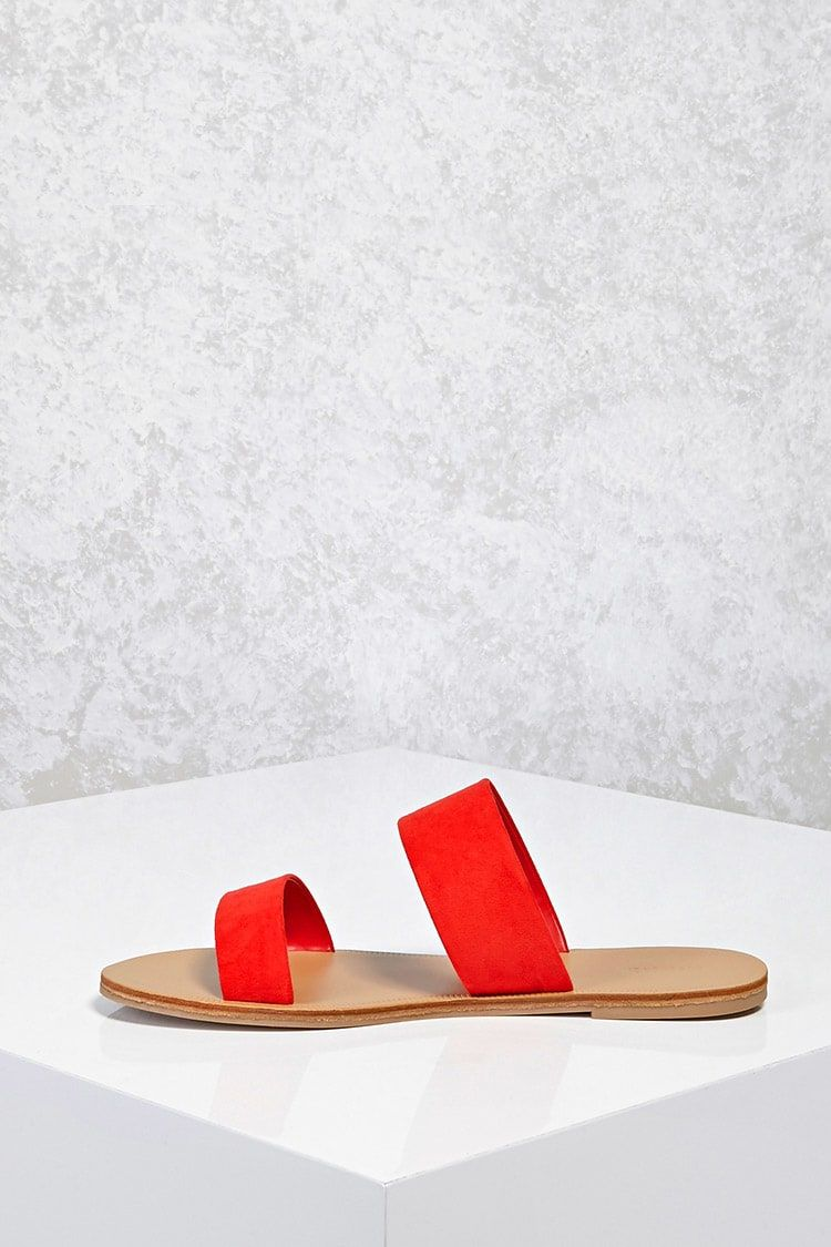 A pair of faux suede sandals featuring a strapped front, open toe, and a low heel.