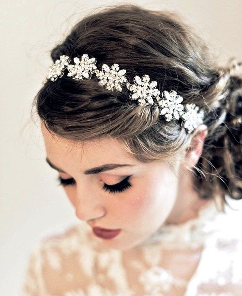 brides messy low bun with swarovski flower headband