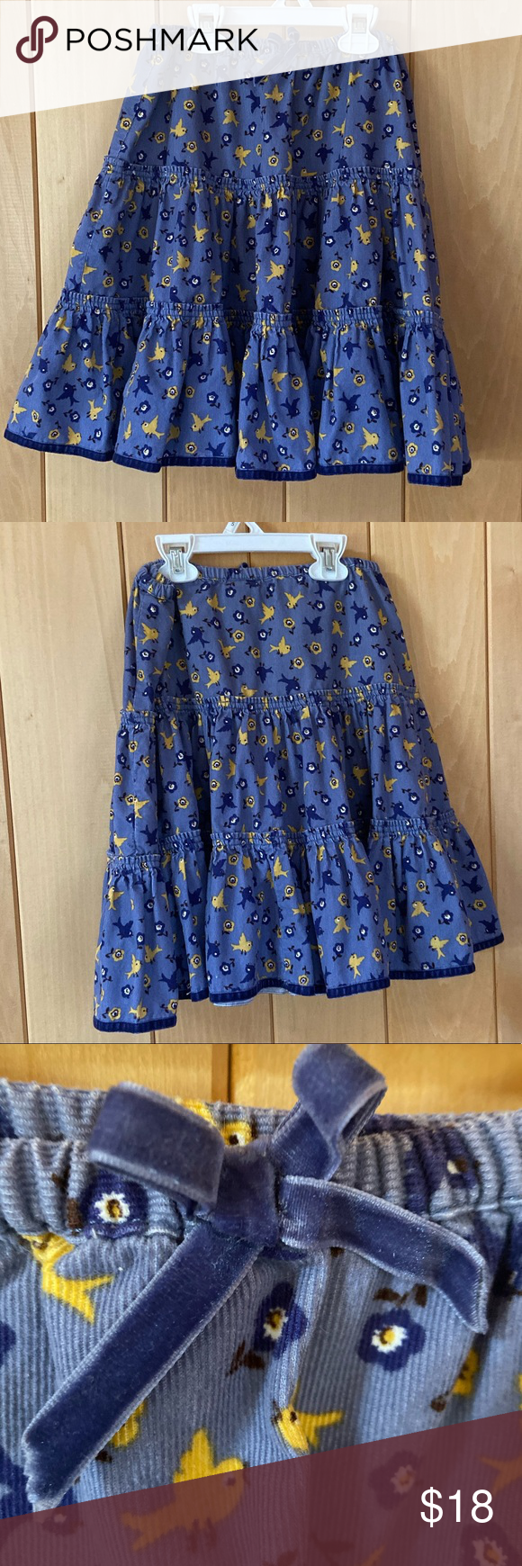Mini Boden corduroy tiered twirl skirt So cute! Mini Boden corduroy tiered twirl skirt with sweet bird print and ribbon detail at waist. Good used condition. Size is 7-8 but waist seems larger and has a good amount of stretch. Mini Boden Bottoms Skirts #twirlskirt