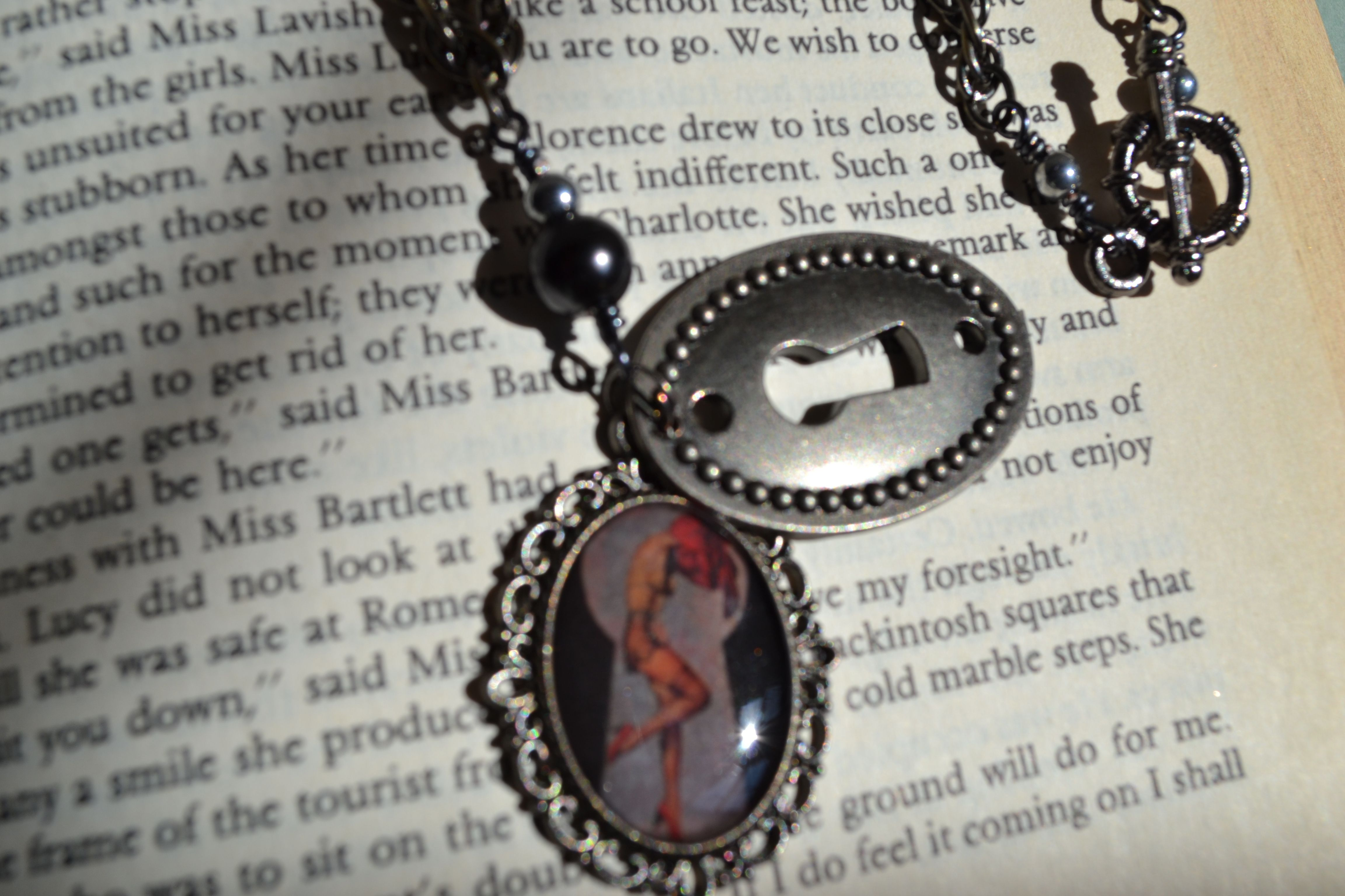 Peekaboo Pinup girl necklace.  On etsy, shop name Good2BGiddy.  New items frequently.