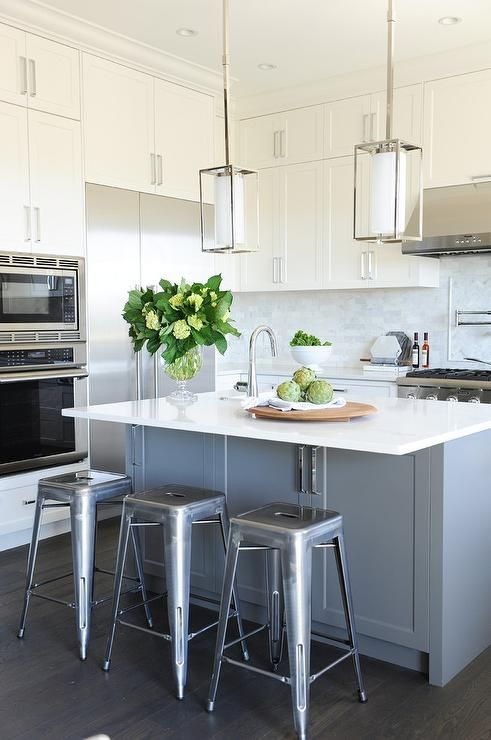 Tolix Stools Seated At A Gray Island With A White Quartz Countertop Overhang Love This Look But Wit Quartz Countertops Kitchen Design White Quartz Countertop