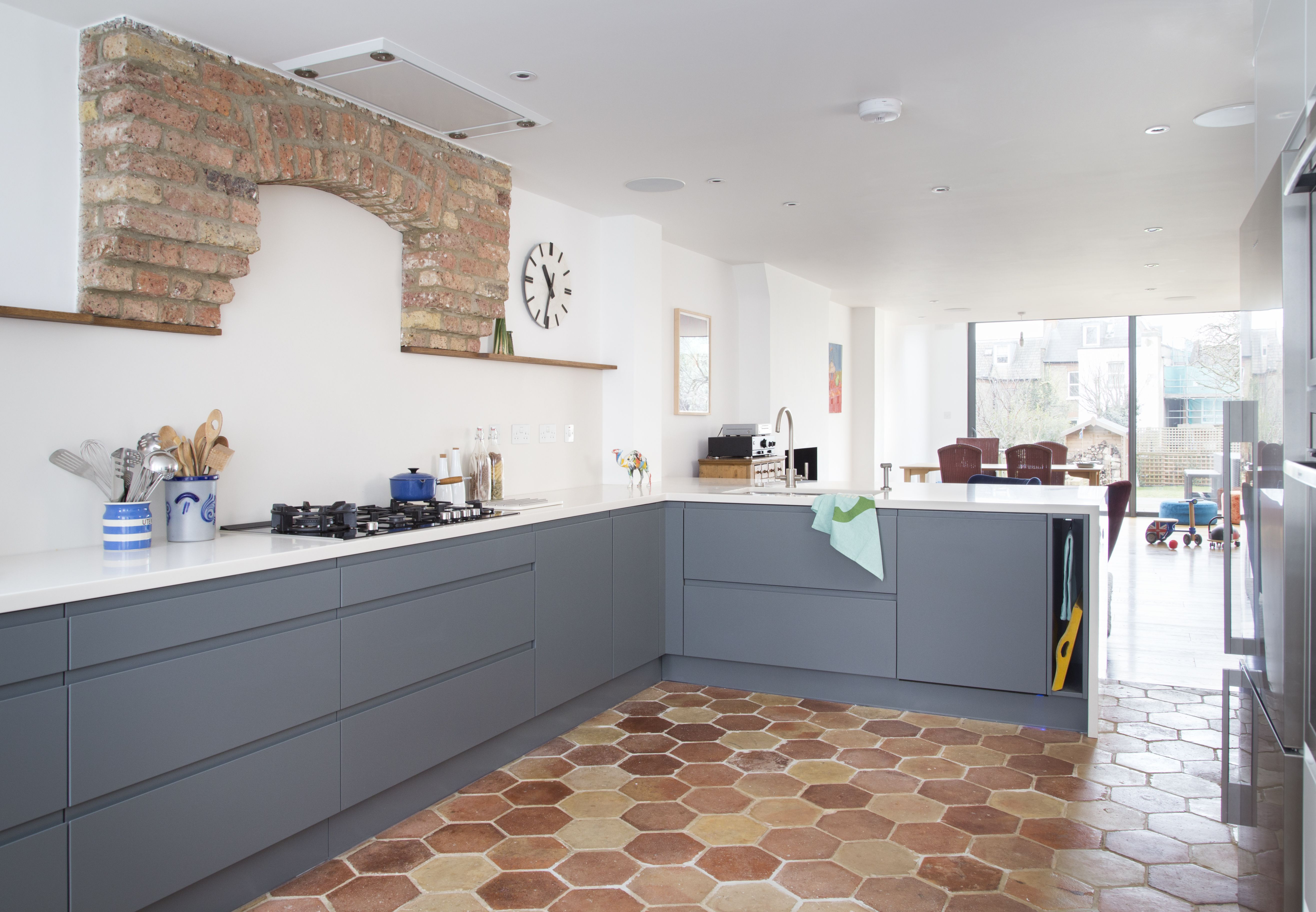 Hexagonal Terracotta Floor Tiles Bounce Off The Original Brick Work