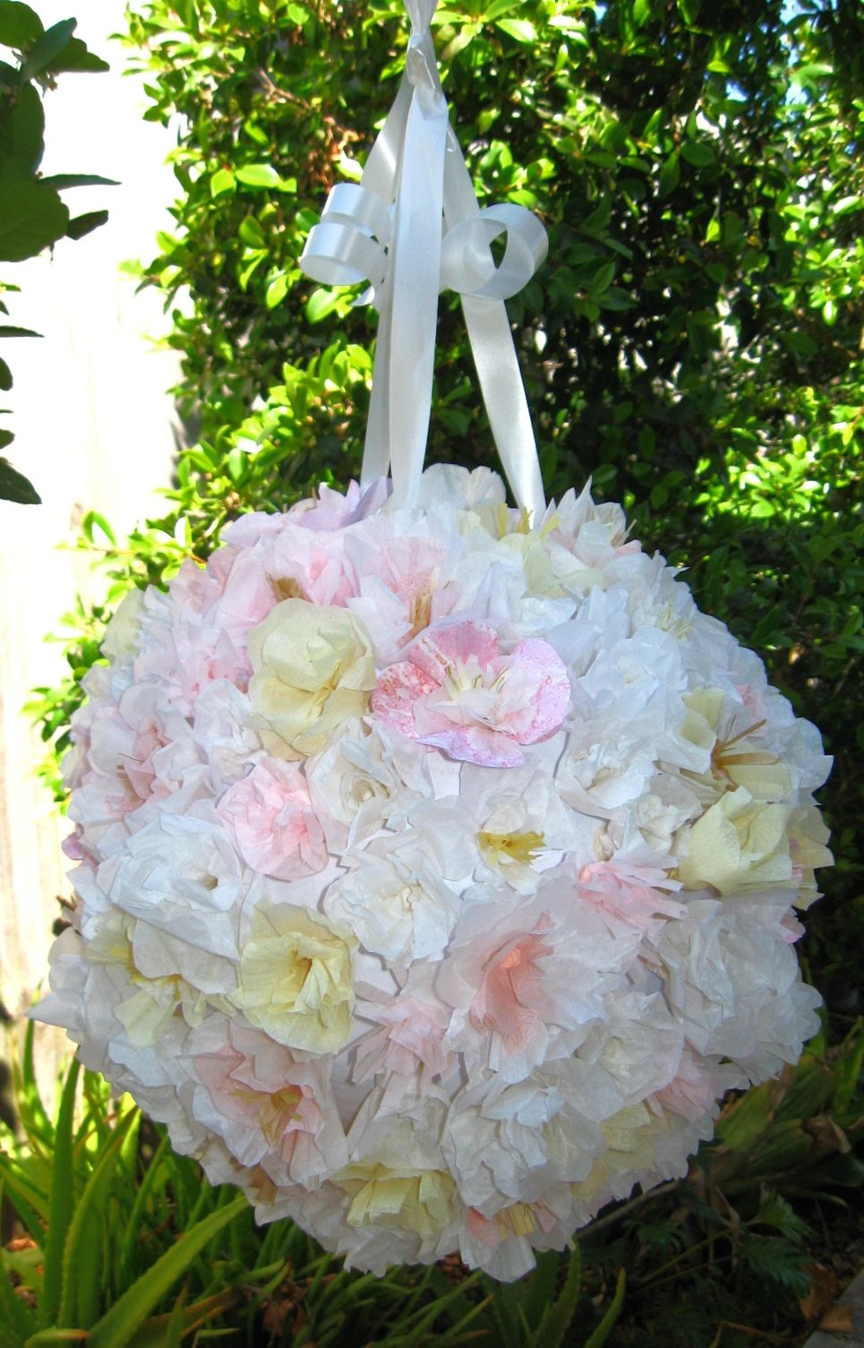 Quickie wedding ideas  Lots of tissue paper flowers on this wedding piñata  Some of our