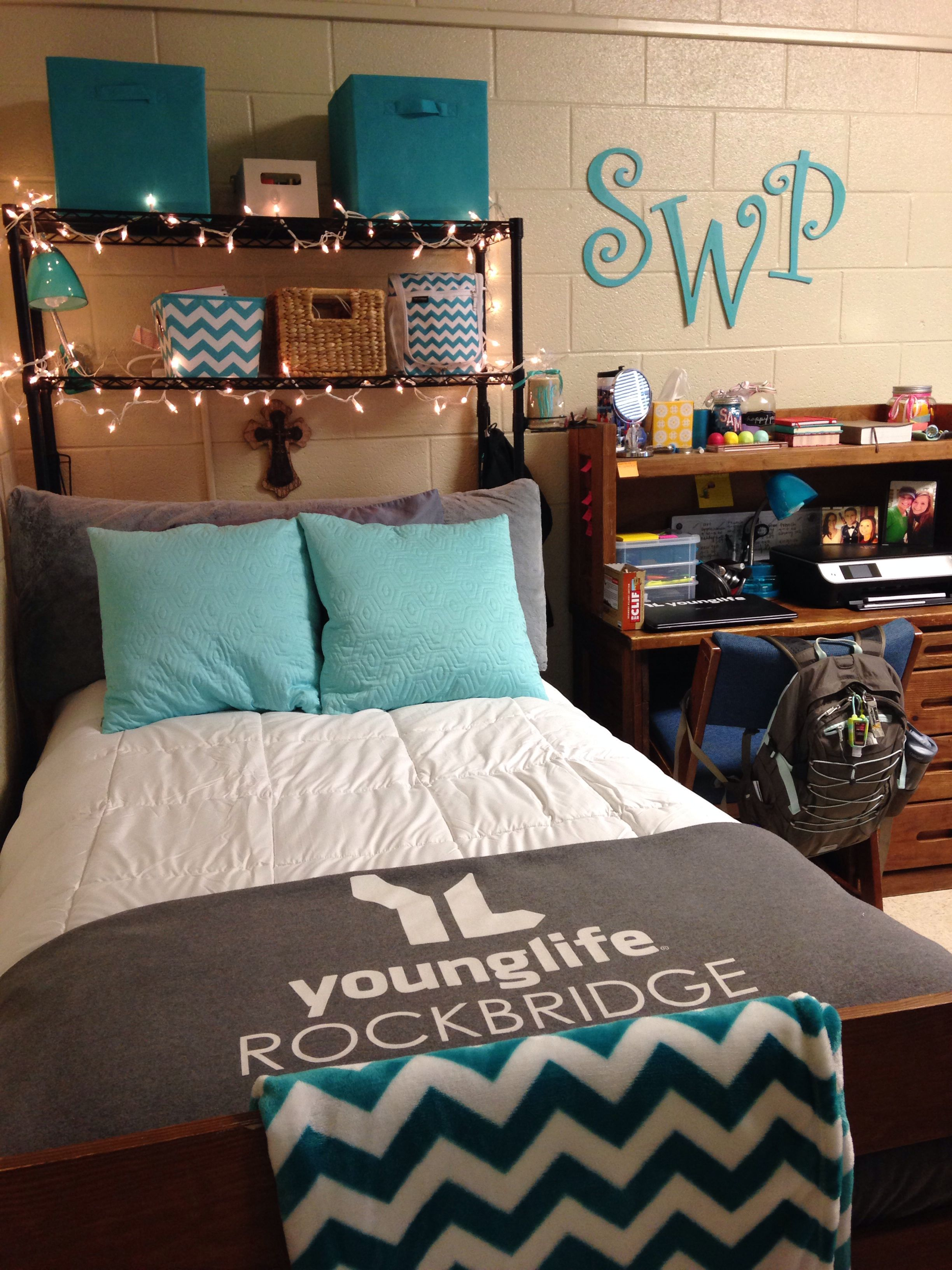 my bed in my gray and teal college dorm room used over the bed organizer from bed bath and beyond strung christmas lights up on the organizer of course