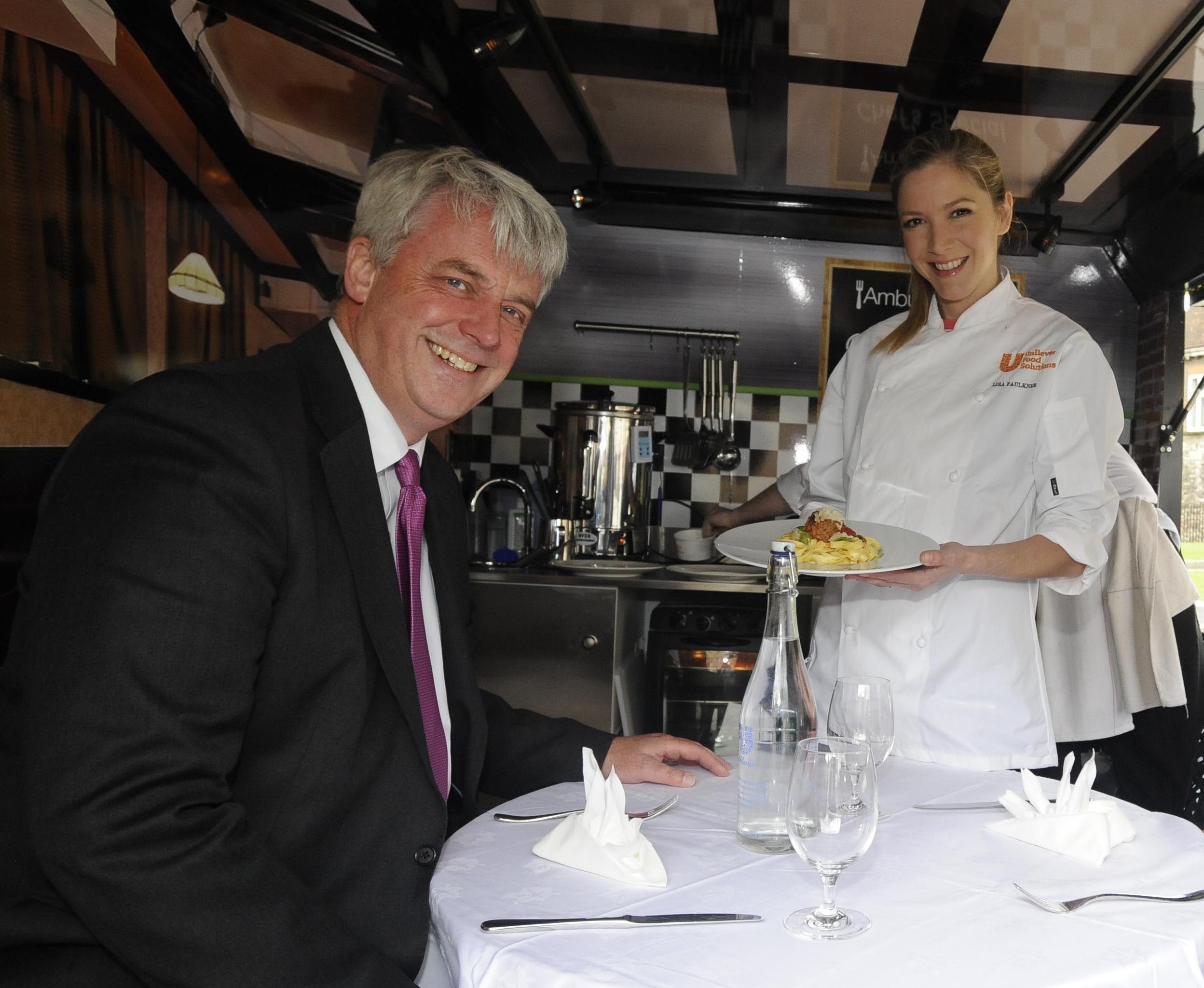 Health Secretary Andrew Lansley and Celebrity MasterChef winner Lisa Faulkner on board the 'Ambu-lunch'.