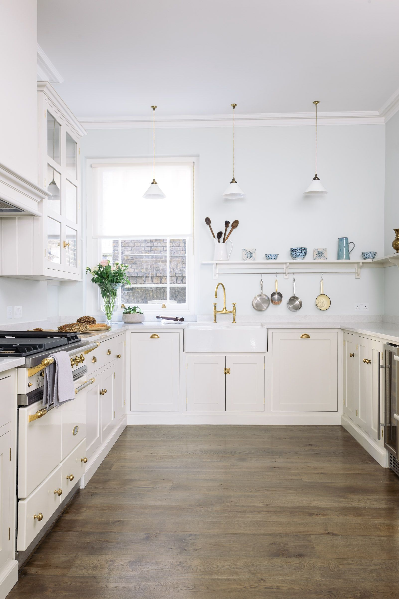 A Beautiful Bright Soft Grey Kitchen With Brass Handles And Taps A - Soft grey kitchen